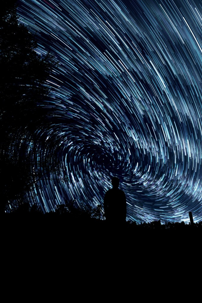 sweeping stars with person night sky